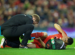 LIVERPOOL, ENGLAND - Wednesday, September 23, 2015: Liverpool's Dejan Lovren goes down with an injury during the Football League Cup 3rd Round match against Carlisle United at Anfield. (Pic by David Rawcliffe/Propaganda)
