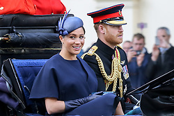 © Licensed to London News Pictures. 08/06/2019. London, UK. Meghan Duchess of Sussex and Prince Harry Duke of Sussex on their way to Buckingham Palace after attending <br />  the Trooping the Colour ceremony to marks the 93rd birthday of Queen Elizabeth II, Britain's longest reigning monarch. Photo credit: Dinendra Haria/LNP