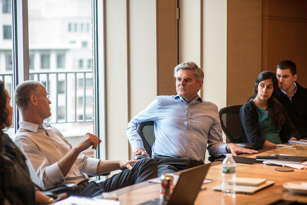 WASHINGTON, DC -- 5/30/17 -- Steve Case, center, participates in a meeting with partners and staff at Revolution headquarters. <br /> Steve Case, is the Chair and CEO of Revolution LLC, which funds companies and entrepreneurs in communities outside of Silicon Valley. He is also the co-founder of America Online and is a billionaire.&hellip;by Andr&eacute; Chung #_AC17816