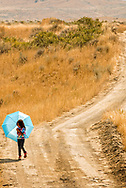 Girl, umbrella, Crow Fair, Crow Indian Reservation, Montana