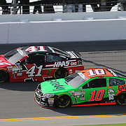 Sprint Cup Series driver Danica Patrick (10) and Sprint Cup Series driver Kurt Busch (41) speed down the front stretch during the 57th Annual NASCAR Coke Zero 400 practice session at Daytona International Speedway on Friday, July 3, 2015 in Daytona Beach, Florida.  (AP Photo/Alex Menendez)