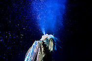 Karen O of the Yeah Yeah Yeahs, spits water out of her mouth during their set on the first day of the 2013 Coachella Valley Music and Arts Festival in Indio, Calif. Friday..