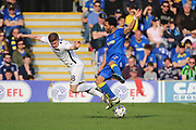 AFC Wimbledon striker Andy Barcham (17) battles for possession with Northampton Town defender Aaron Phillips (18) during the EFL Sky Bet League 1 match between AFC Wimbledon and Northampton Town at the Cherry Red Records Stadium, Kingston, England on 11 March 2017. Photo by Matthew Redman.