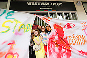 L-R , Niamh 8, Grace 8,  and Zeah 8 outside Maxilla Children's centre.<br /> <br /> On Sunday the 5th of July Westway 23 held a creative demonstration of community in along the 23 acres underneath the Westway - A40 in Labroke Grove. <br /> <br /> Westway23 is a grass roots organisation formed of concerned local residents, organisations, traders and artists of all ages, ethnicities and backgrounds, united to defend the rights of the local community of Ladbroke Grove, Notting Hill, West London in relation to the 23 acres of land held in trust for the benefit of local residents by Westway Trust.<br /> <br /> Photo: Zute Lightfoot