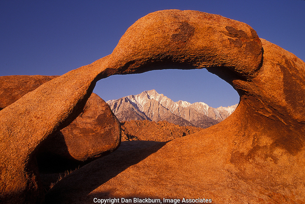 Sunrise Arch Frames Lone Pine Peak in the Sierra from the Alabama Hills in Early Morning Light.