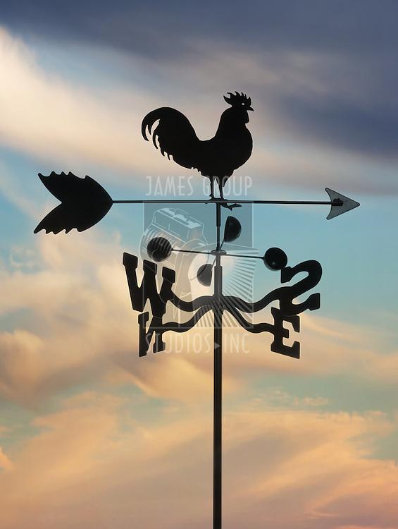 iron weathervane against cloudscape