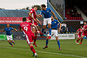 Macclesfield Town defender Theo Vassell in areal challenge with the opponent during the EFL Sky Bet League 2 match between Macclesfield Town and Morecambe at Moss Rose, Macclesfield, United Kingdom on 20 August 2019.