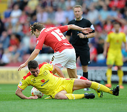 Bristol City's Luke Freeman is challenged by Milton Keynes Dons' Darren Potter - Photo mandatory by-line: Dougie Allward/JMP - Mobile: 07966 386802 - 27/09/2014 - SPORT - Football - Bristol - Ashton Gate - Bristol City v MK Dons - Sky Bet League One