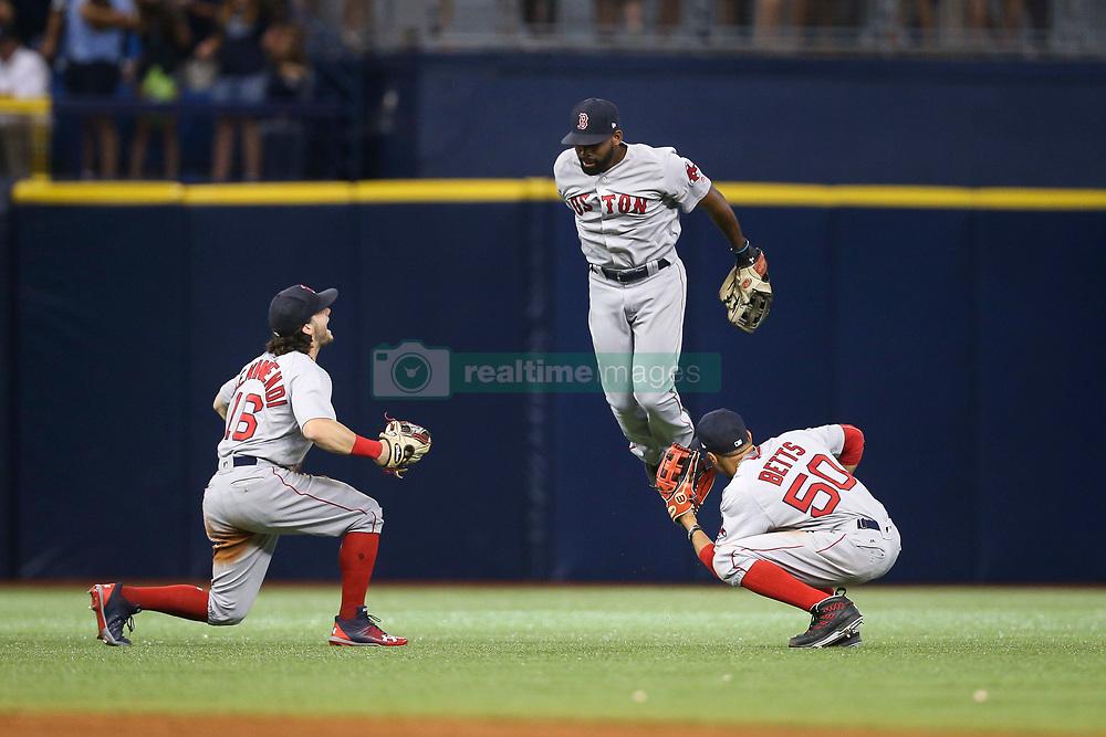 August 8, 2017 - St. Petersburg, Florida, U.S. - WILL VRAGOVIC   |   Times.Boston Red Sox left fielder Andrew Benintendi (16), center fielder Jackie Bradley Jr. (19), and right fielder Mookie Betts (50) celebrate after the game between the Boston Red Sox and the Tampa Bay Rays at Tropicana Field in St. Petersburg, Fla. on Tuesday, August 8, 2017. The Boston Red Sox beat the Tampa Bay Rays 2-0. (Credit Image: © Will Vragovic/Tampa Bay Times via ZUMA Wire)