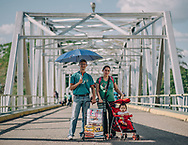 Carlos, 41 years old - Erika, 36 years old and their daughter 1 year old, schoolteachers<br /> They spent 4 hours traveling and buying the products.<br /> 2.9 minimum wage equivalent to 29 USD aprox.<br /> Sugar, rice, cornmeal, diapers.