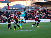 Shane DUFFY getting fouled in front of ref during the Sky Bet Championship match between Brentford and Blackburn Rovers at Griffin Park, London, England on 13 December 2014.