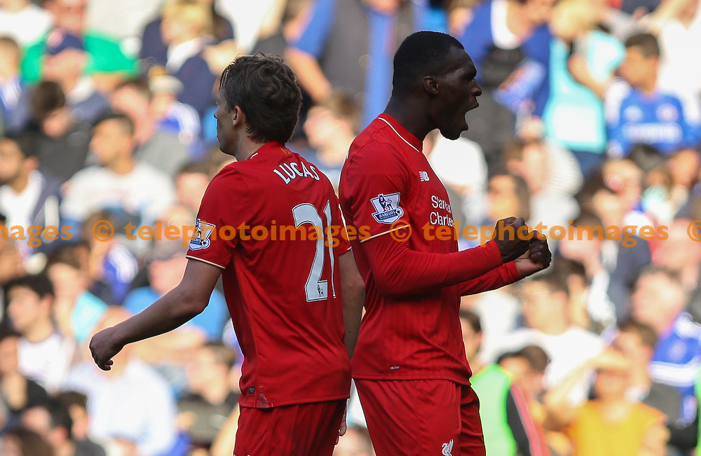 Christian Benteke of Liverpool (right) celebrates scoring to make it 1-3 during the Barclays Premier League match between Chelsea and Liverpool at Stamford Bridge in London. October 31, 2015.<br /> Arron Gent / Telephoto Images<br /> +44 7967 642437