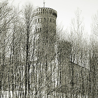 The Castle Granitz in springtime with snow behind bushes.