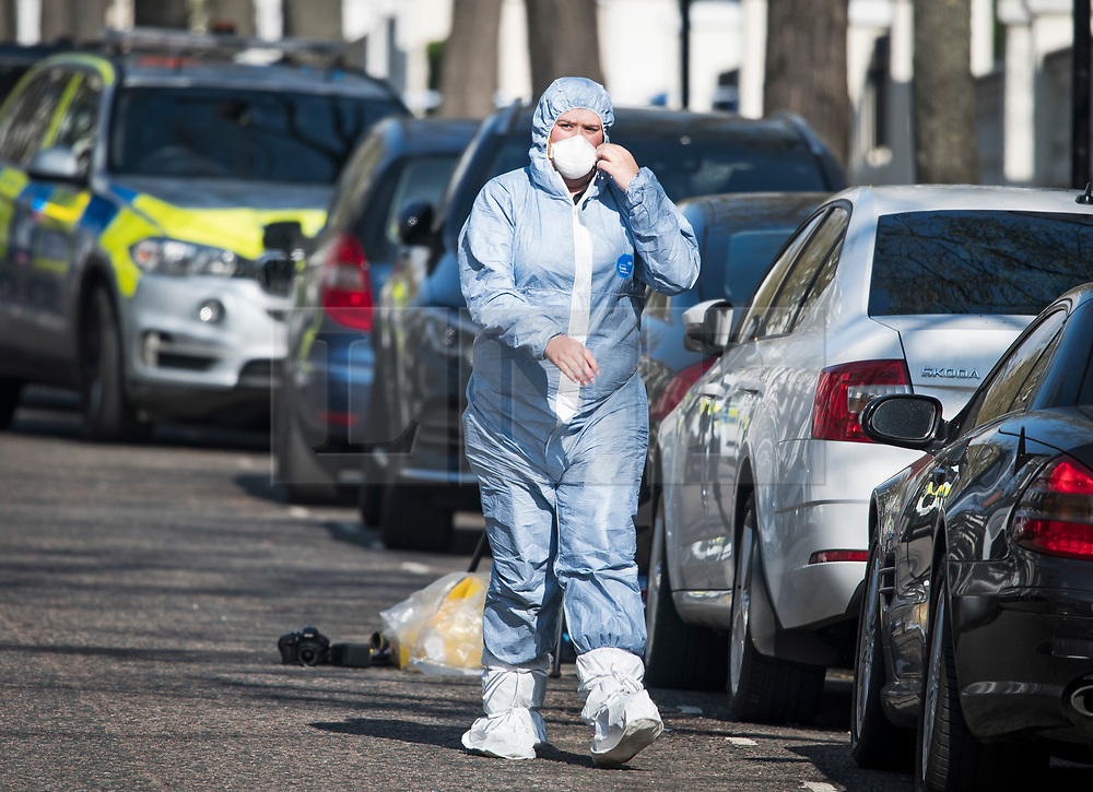 © Licensed to London News Pictures. 13/04/2019. London, UK. Police forensics at the scene in Holland Park after shots were fired near the Ukrainian embassy. Photo credit: Ben Cawthra/LNP