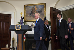 August 2, 2017 - Washington, District of Columbia, United States of America - United States President President J. Donald Trump arrives before making an announcement on the introduction of the Reforming American Immigration for a Strong Economy (RAISE) Act with US Senator Tom Cotton (Republican of Arkansas) and US Senator David Perdue (Republican of Georgia) in the Roosevelt Room at the White House in Washington, D.C., U.S., on Wednesday, August 2, 2017. The act aims to overhaul U.S. immigration by moving towards a ''merit-based'' system.  .Credit: Zach Gibson / Pool via CNP (Credit Image: © Zach Gibson/CNP via ZUMA Wire)