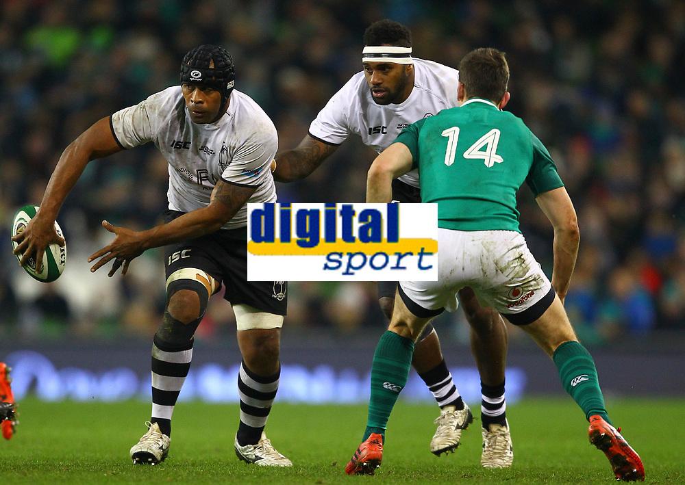 Rugby Union - 2017 Guinness Series (Autumn Internationals) - Ireland vs. Fiji<br /> <br /> Akapusi Qera (Fiji) attempts an offload under pressure from Darren Sweetnam (Ireland), at the Aviva Stadium.<br /> <br /> COLORSPORT/KEN SUTTON