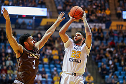 Dec 30, 2018; Morgantown, WV, USA; West Virginia Mountaineers forward Esa Ahmad (23) shoots a three pointer during the second half against the Lehigh Mountain Hawks at WVU Coliseum. Mandatory Credit: Ben Queen-USA TODAY Sports
