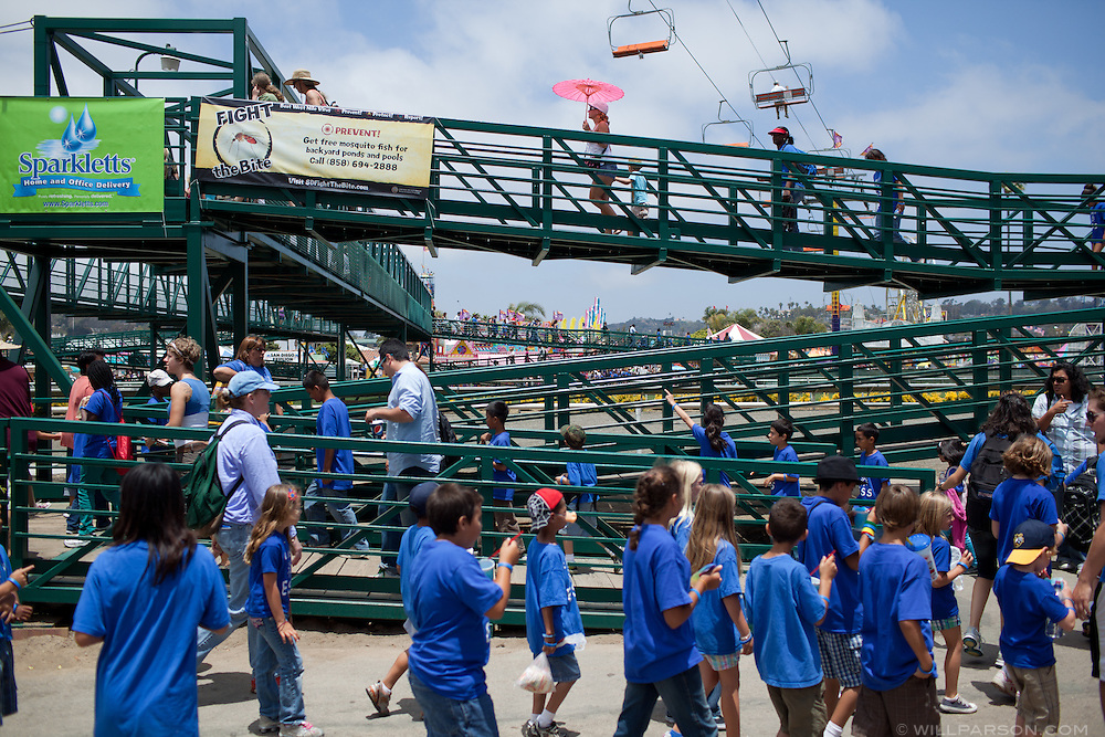 Visitors walk to attractions on the Del Mar Racetrack infield.