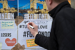 June 8, 2017 - London, London, United Kingdom - Image ©Licensed to i-Images Picture Agency. 08/06/2017. London, United Kingdom. A tribute note left by London Bridge, which was graffitied with the words: ''Staged Hoax'', is crossed out by a member of the public. Picture by David Mirzoeff / i-Images (Credit Image: © David Mirzoeff/i-Images via ZUMA Press)