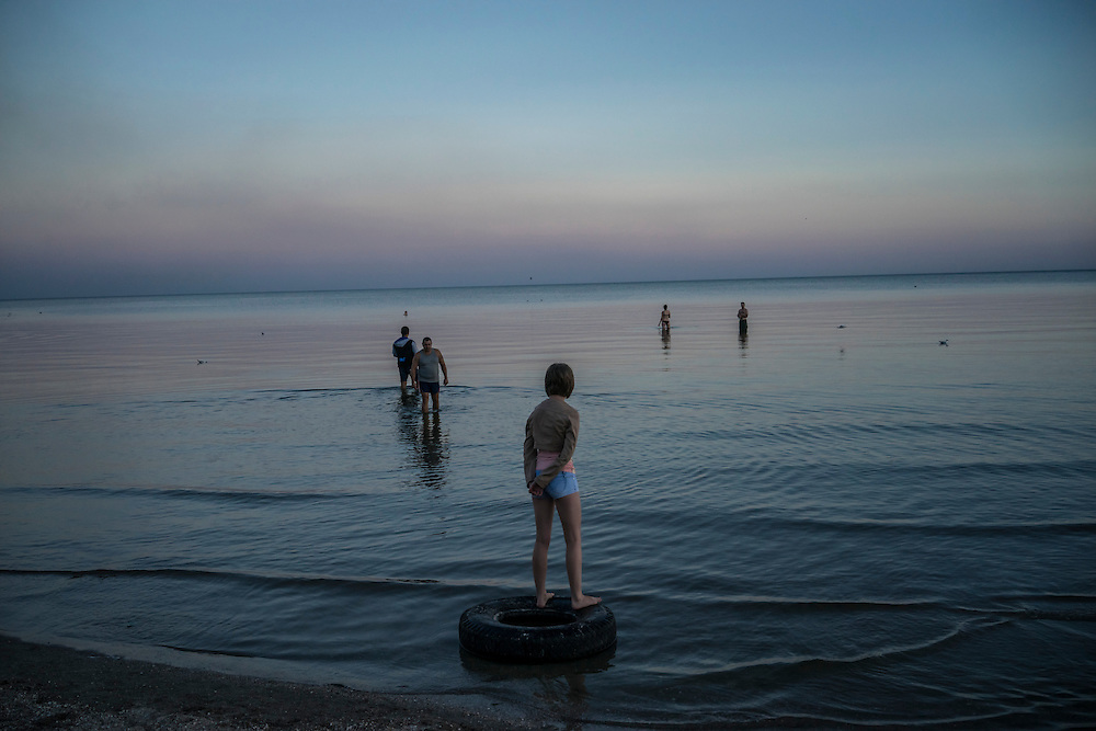 MARIUPOL, UKRAINE - AUGUST 30, 2015: The beach at sunset in Mariupol, Ukraine. Despite the front line being a relatively short distance away, Mariupol was lively on a warm summer weekend, with little evidence that people expect the fighting to advance this far. CREDIT: Brendan Hoffman for The New York Times