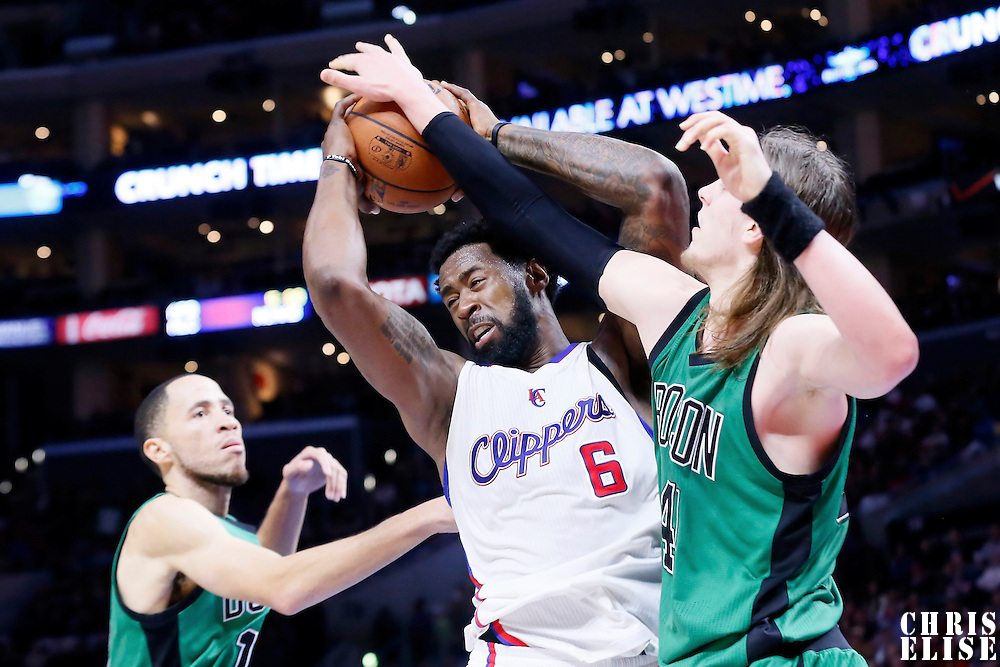 19 January 2015: Los Angeles Clippers center DeAndre Jordan (6) grabs the rebound over Boston Celtics center Kelly Olynyk (41) during the Los Angeles Clippers 102-93 victory over the Boston Celtics, at the Staples Center, Los Angeles, California, USA.