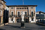 The town hall in Getaria and statue of juan Sebastian Elcano.