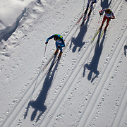 Winter Olympics, Vancouver, 2010.The shadows of athletes cast on the surface of the snow during the Men's 30km Pursuit Cross Country event at Whistler Olympic Park, Whistler, during the Vancouver Winter Olympics. 20th February 2010. Photo Tim Clayton