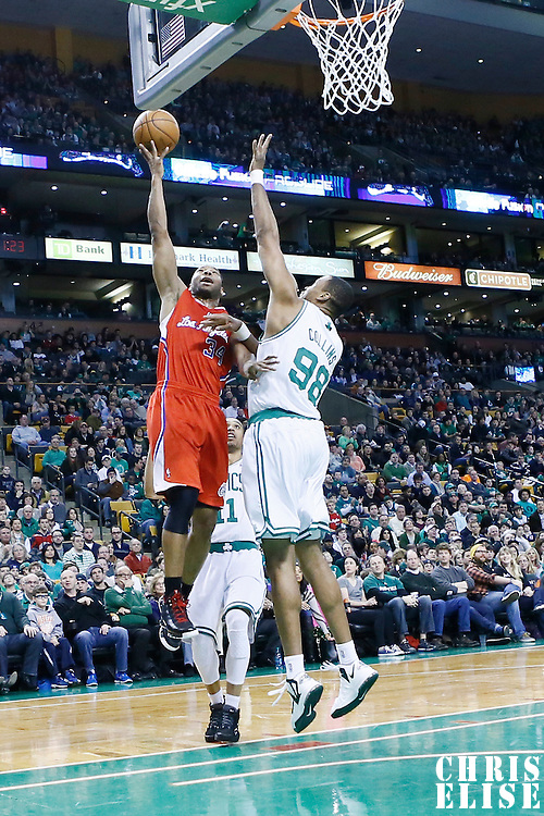 03 February 2013: Los Angeles Clippers shooting guard Willie Green (34) goes for the layup over Boston Celtics center Jason Collins (98) during the Boston Celtics 106-104 victory over the Los Angeles Clippers at the TD Garden, Boston, Massachusetts, USA.