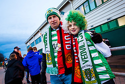 Supporters with half and half Yeovil Town Manchester United shirts as well as scarves - Rogan/JMP - 26/01/2018 - FOOTBALL - Huish Park - Yeovil, England - Yeovil Town v Manchester United - FA Cup Fourth Round.