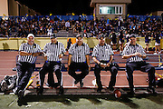 Referees take a break and share stories during halftime between Milpitas High School and Woodside at Milpitas High School in Milpitas, California, on September 13, 2013. The Trojans went on to beat the Wildcats 50-6. (Stan Olszewski/SOSKIphoto)