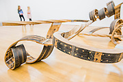 Tate Britain launches its major spring show, exhibiting the work of Turner Prize-winning artist Richard Deacon (b.1949). It includes large sculptures made of twisted wood, metal, and ceramic such as: Fold 2012, a towering sculpture weighing over 12 tonnes and made of 60 shimmering glazed ceramic bricks; After 1998, a huge serpentine wooden structure that is over 9 metres at its longest point; and Out of Order 2003, a sprawling sculpture constructed from ribbons of steamed wood (pictured). The Tate Britain, London, UK 03 February 2014. Guy Bell, 07771 786236, guy@gbphotos.com