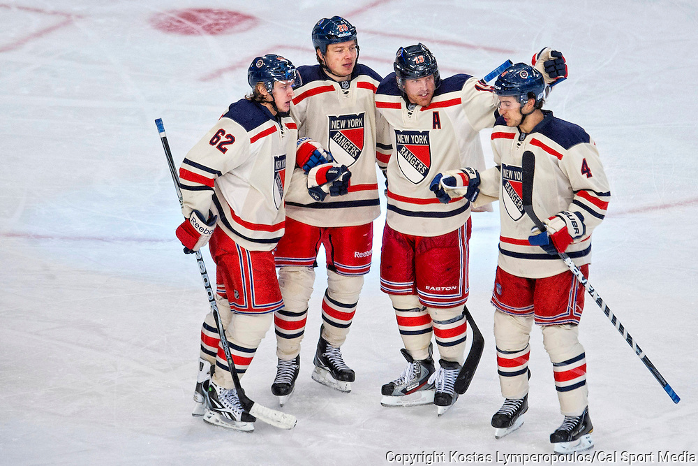 February 5  2012: New York Rangers player Ruslan Fedotenko (26) celebrates with Carl Hagelin (62), Michael Del Zotto (4) and Brad Richards (19) after scoring an empty net goal in the third period at  Madison Square Garden in Manhattan, New York between the New York Rangers and the Philadelphia Fyers . The New York Rangers defeat The Philadelphia Flyers 5-2.(Credit Image: © Kostas Lymperopoulos/Cal Sport Media)