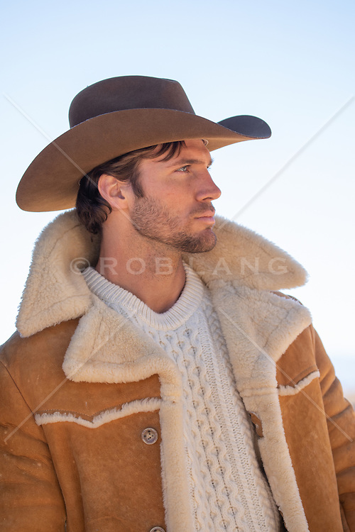 profile of a hot cowboy in a shearling jacket