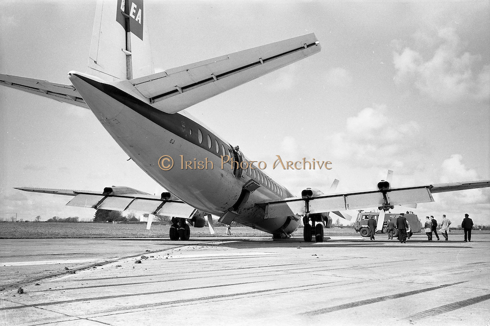 29/03/1963<br /> 03/29/1963<br /> 29 March 1963<br /> B.E.A. Aircrash at Dublin Airport. The crashed BEA Vanguard G-APEJ that carried 43 passengers and seven crew from London to Dublin ploughed its way through half a mile of grassland before returning to the concrete runway, when its front undercarriage appeared to have failed on arrival at Dublin Airport. There were no fatalities in the accident. Note Airport Fire Services vehicle a Thorneycroft Sun Foam Tender in background, also fire officer in door of aircraft.