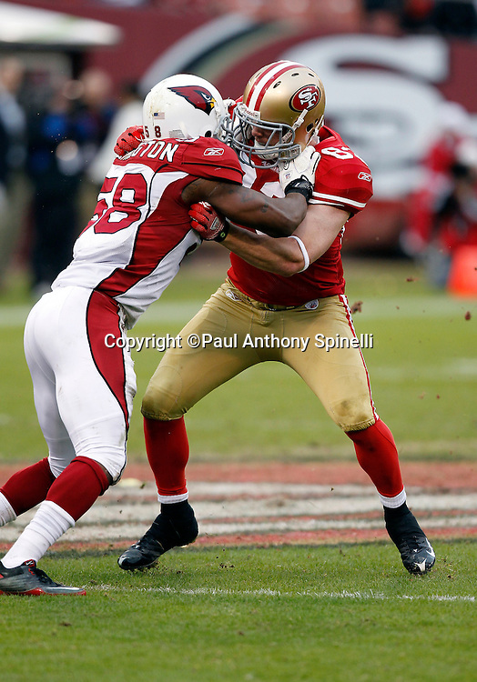 San Francisco 49ers tight end Colin Cloherty (83) blocks Arizona Cardinals linebacker Daryl Washington (58) during the NFL week 17 football game against the Arizona Cardinals on Sunday, January 2, 2011 in San Francisco, California. The 49ers won the game 38-7. (©Paul Anthony Spinelli)