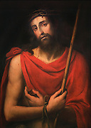 Ecce Homo, painted 19th century by Mariano Salvador Maella, 1739-1819, a copy of a painting by Juan de Juanes, 1475-1579, in Spanish Renaissance style, in the Metropolitan Cathedral-Basilica of the Assumption of Our Lady of Valencia, Valencia, Spain. Christ is injured, bound and wears a crown of thorns before his crucifixion. The angel is holding a sword and a royal crown. The cathedral is a Roman Catholic parish church consecrated in 1238 and reworked several times over the centuries. Picture by Manuel Cohen