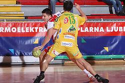 Marko Ristic vs David Spiler at 15th round of Slovenian Handball MIK 1st league match between RD Slovan and RK Celje Pivovarna Lasko, on February 6, 2009, in Kodeljevo, Ljubljana, Slovenia. Win of RK Slovan 18:17. (Photo by Vid Ponikvar / Sportida)