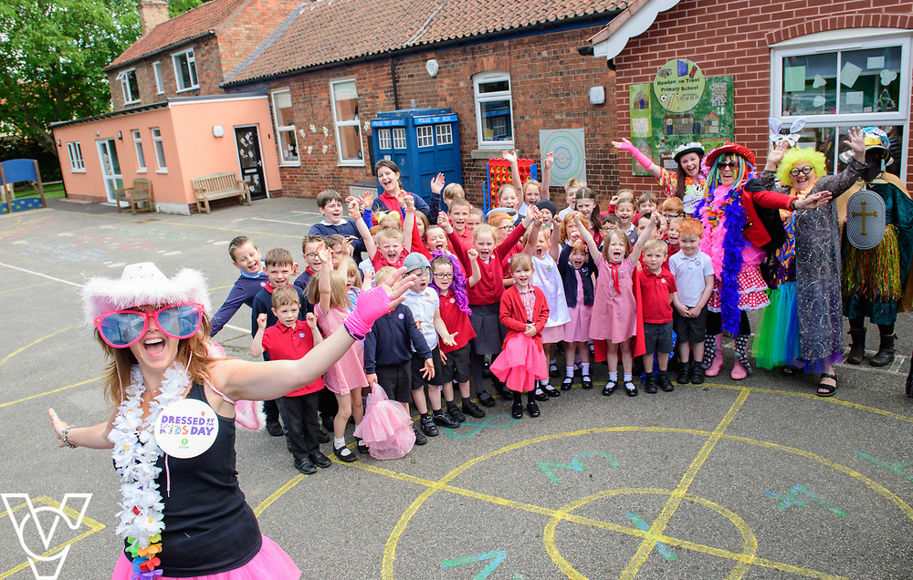Newton on Trent Primary School, in Newton-on-Trent, near Lincoln, have been taking part in Oxfam's Dressed By The Kids Day.  Pictured is Sam Wilks, front left, surrounded by colleagues and pupils taking part in Oxfam's Dressed By The Kids Day.<br /> <br /> Picture: Chris Vaughan Photography for Oxfam<br /> Date: June 13, 2017