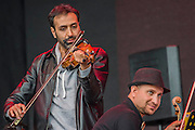 The violin soloist - Damon Albarn introduces and plays with the Orchestra of Syrian Musicians on the Pyramid Stage - The 2016 Glastonbury Festival, Worthy Farm, Glastonbury.