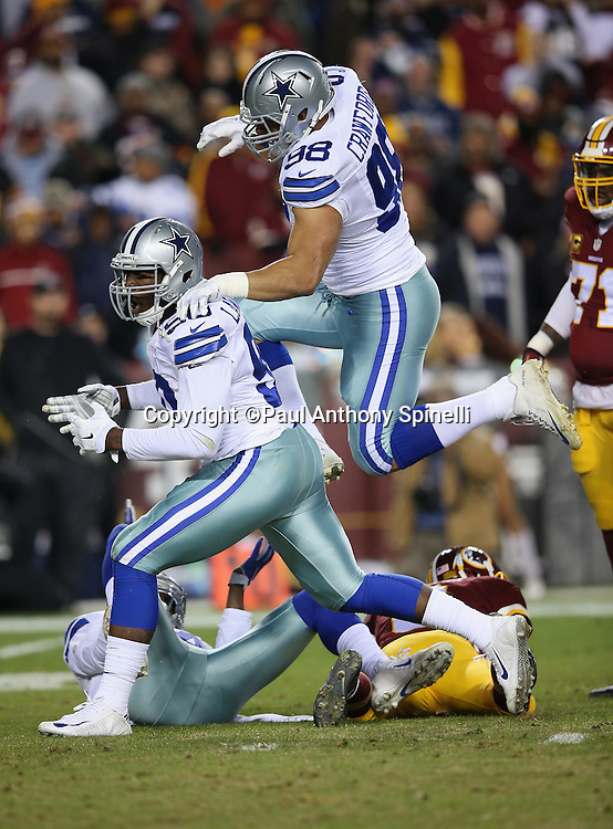 Dallas Cowboys defensive tackle Tyrone Crawford (98) leaps and celebrates with Dallas Cowboys defensive end Demarcus Lawrence (90) after Lawrence sacks Washington Redskins quarterback Kirk Cousins (8) on the third play of the first quarter causing a fumble and setting the tone for a defensive struggle during the 2015 week 13 regular season NFL football game against the Washington Redskins on Monday, Dec. 7, 2015 in Landover, Md. The Cowboys won the game 19-16. (©Paul Anthony Spinelli)