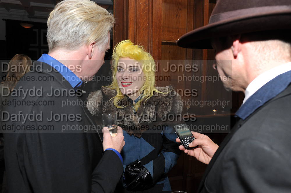 PHILIP TREACY; PAM HOGG; STEFAN BARTLETT, London College of Fashion hosts party to celebrate the opening of Carmen: A Life in Fashion with guest of honour Carmen Dell'Orefice. Il Bottachio, Hyde Park Corner. London. 16 November 2011. <br /> <br />  , -DO NOT ARCHIVE-© Copyright Photograph by Dafydd Jones. 248 Clapham Rd. London SW9 0PZ. Tel 0207 820 0771. www.dafjones.com.