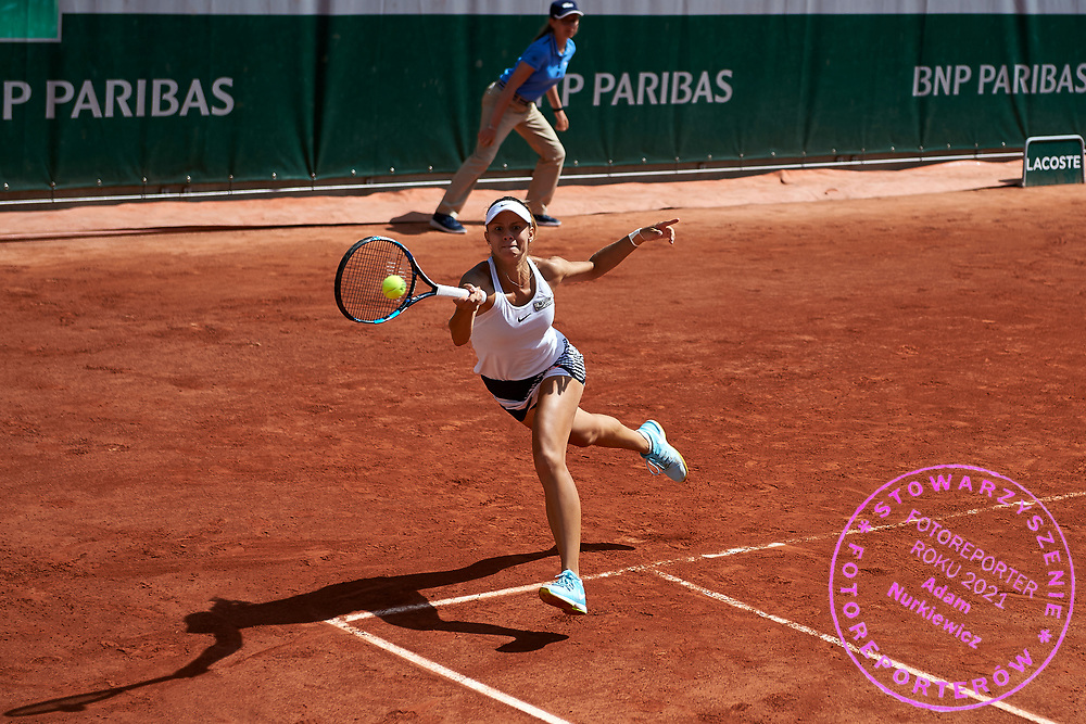 Paris, France - 2017 May 31: Magda Linette from Poland plays a forehand while her women's double match first round during tennis Grand Slam tournament The French Open 2017 (also called Roland Garros) at Stade Roland Garros on May 31, 2017 in Paris, France.<br /> <br /> Mandatory credit:<br /> Photo by &copy; Adam Nurkiewicz<br /> <br /> Adam Nurkiewicz declares that he has no rights to the image of people at the photographs of his authorship.<br /> <br /> Picture also available in RAW (NEF) or TIFF format on special request.<br /> <br /> Any editorial, commercial or promotional use requires written permission from the author of image.