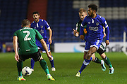 Jamie Reckord of Oldham Athletic runs at Scunthorpe United defender Scott Wiseman (2) during the EFL Sky Bet League 1 match between Oldham Athletic and Scunthorpe United at Boundary Park, Oldham, England on 18 October 2016. Photo by Simon Brady.