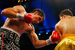 April 12, 2008; Atlantic City, NJ, USA;  Antonio Margarito (Black w/Red) and Kermit Cintron (Gold w/Red) trade punches during their 12 round IBF Welterweight Championship fight at Boardwalk Hall in Atlantic City, NJ. Margarito knocked out Cintron in the 6th round to capture the title.