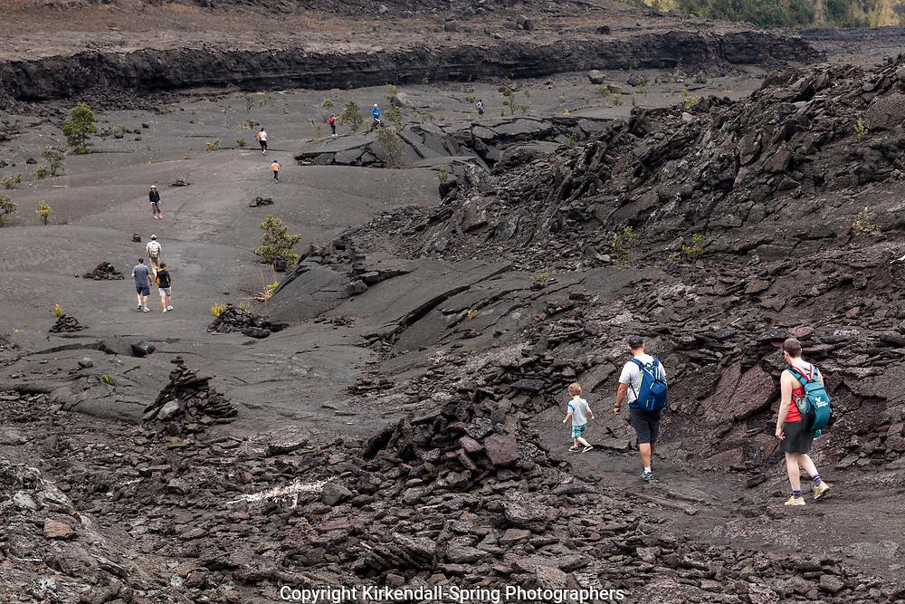 HI00375-00...HAWAI'I - Hikers crossing the Kilauea Iki Crater in Hawai'i Volcanoes National Park.