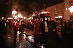 © Licensed to London News Pictures. 31/12/2016. Allendale, UK.  A procession of guisers in costume parade through the town of Allendale in Northumberland bearing aloft half-barrels filled with tar and flames. The annual Allendale Tar Barrel, or Tar Barl, event is a traditional custom which takes place on the eve of December 31st and welcomes in the new year. Photo credit : Ian Hinchliffe/LNP