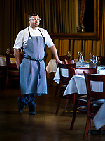 Seviche chef and owner Anthony Lamas poses for a portrait in the main dinning room of Seviche.