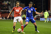 Nottingham Forest midfielder Chris Cohen (8) battles for possession with Birmingham City forward Lukas Jutkiewicz (15) during the EFL Sky Bet Championship match between Nottingham Forest and Birmingham City at the City Ground, Nottingham, England on 14 October 2016. Photo by Jon Hobley.