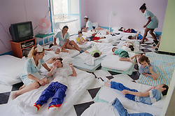 Children with disabilities at centre for rehabilitation and education in Havana; Cuba; having their siesta,