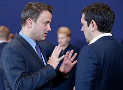 Luxembourg Prime Minister Xavier Bettel (L) talks with Greece Prime Minister Alexis Tsipras at family photo session during a two-day European Union leaders summit at the EU Council headquarters in Brussels, Belgium, March 17, 2016. EXPA Pictures © 2016, PhotoCredit: EXPA/ Photoshot/ Ye Pingfan<br /> <br /> *****ATTENTION - for AUT, SLO, CRO, SRB, BIH, MAZ, SUI only*****